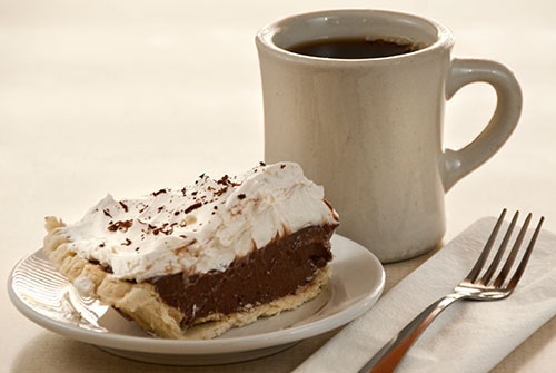 slice of chocolate pie with coffee
